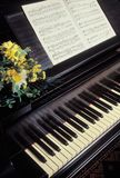 Piano with sheet music. A grand piano with sheet music Stock Images
