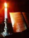 Piano and sheet music in the candle lighting. Piano and opened book with sheet music royalty free stock image