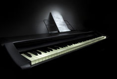 Piano with sheet music. Isolated on a  black background Royalty Free Stock Images