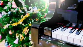 Piano and shine to star with Christmas tree royalty free stock photos