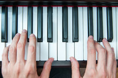 Piano and singer hands Stock Images