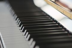 Piano. soft baackground. music, musical. Piano. music. close up on the piano and the sheet. black and white royalty free stock photos
