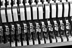 Piano string dampers. Lined up in monochrome Royalty Free Stock Image