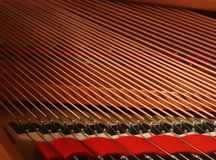 Piano strings. Closeup of a piano inside, parallel strings in a diagonal composition Stock Photo