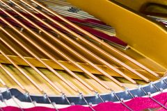 Piano strings. Close-up photo. stock images
