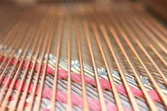 Piano strings. A closeup of piano strings Stock Image