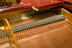 Piano strings and hammers. A view looking into the inner strings and hammers of a baby grand piano Stock Photo