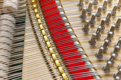 Piano strings and hammers background Stock Image