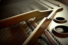 Piano. Strings inside a baby grand stock photography
