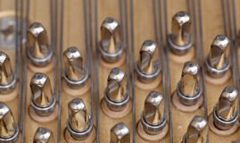 Piano strings in macro. Close up image of interior of grand piano showing strings and structure royalty free stock image