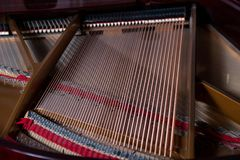 Piano strings royalty free stock photography