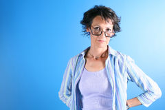 Piano Teacher. Stern looking older woman with big glasses Royalty Free Stock Photography