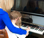 Piano teaching. Stock Image