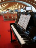 Piano at a terminal of Charles de Gaulle airport. Charles de Gaulle airport, France-May 9, 2015: A piano was placed for playing freely Royalty Free Stock Photos