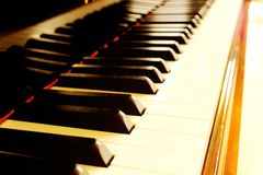 Piano touched by the sun beams Royalty Free Stock Photography