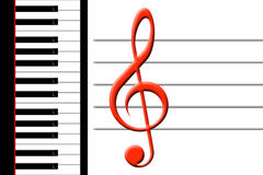 Piano and treble clef Stock Images