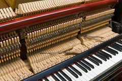 Piano tuning. Tools for setting lie on the internal levers and hammers the piano royalty free stock photo