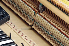 Piano tuning 5. Detailed view of Upright Piano during tuning Stock Image