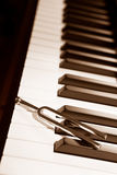 Piano and tuning forl Stock Images