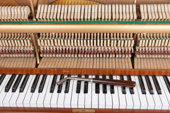 Piano. Tuning key on an old opened upright piano Royalty Free Stock Photos