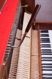 Piano. Tuning key on pin of upright piano. Process of tuning Stock Photos