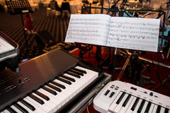 Piano. Two pianos and the musical notes. on a stand Royalty Free Stock Photography