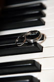 Piano and Wedding rings Stock Photos