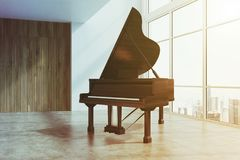 Black piano in a white and wooden room toend Royalty Free Stock Photography