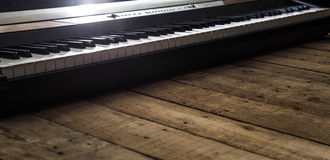Piano on wooden background closeup Stock Photography