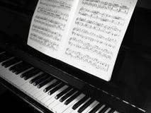 Piano y notas Foto de archivo libre de regalías