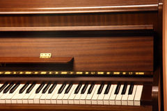 Pianos. Closeup of a brown piano, shallow depth Royalty Free Stock Photography