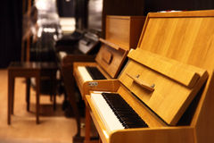 Pianos. Closeup of a brown piano, shallow depth Royalty Free Stock Images