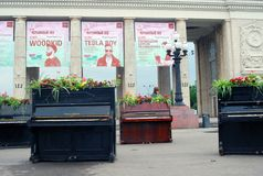 Pianos decorated by flowers. By the entrance to the Gorky park. It's decoration on the occasion of International Chereshnevy Les (Cherry Forest) Open-Art Royalty Free Stock Image