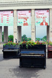 Pianos decorated by flowers. By the entrance to the Gorky park. It's decoration on the occasion of International Chereshnevy Les (Cherry Forest) Open-Art Royalty Free Stock Images