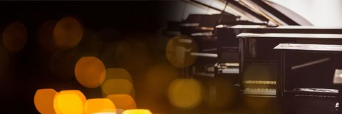 Pianos with yellow lights. Digital composite of Pianos with yellow lights Royalty Free Stock Image