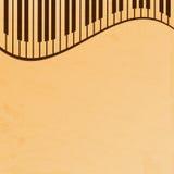 Pianosleutels op een beige grungy achtergrond Stock Afbeeldingen