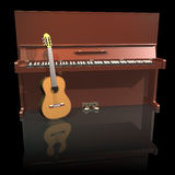 Pianot and guitar on a black background. Piano and guitar isolated on a black background Stock Photo