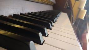 Pianotangenter och stearinljus Royaltyfri Foto