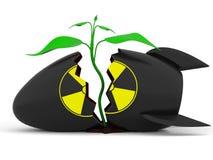 Pianta che cresce attraverso la bomba atomica Immagine Stock