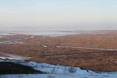 Pianura nebbiosa del paesaggio di inverno Fotografia Stock