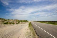 Piasek diuny wzdłuż autostrady Fotografia Royalty Free