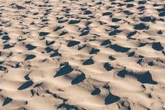 Piasek fala plaży pustyni wydmowa abstrakcjonistyczna tekstura Zdjęcie Stock