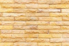 Piasek kamiennej ściany tło dekoruje Obrazy Stock