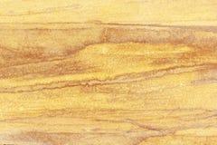 Piasek kamiennej ściany tło dekoruje Fotografia Stock