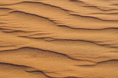 Piasek z fala w czerwieni pustyni Fotografia Stock