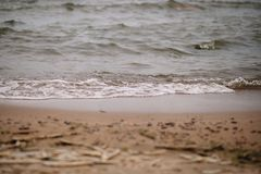 Piaska i morze piany plaży wody tło fotografia royalty free