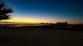 Piaskowata plaża, Skalisty punkt, Meksyk zmierzch Zdjęcia Royalty Free