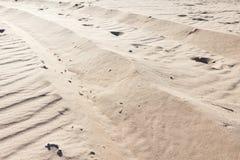 Piaskowaty tło, tekstura sucha piasek pustynia obraz stock