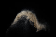 Piaskowaty wybuch odizolowywający na czarnym tle Zdjęcia Stock