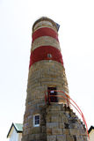 Piaskowcowa latarnia morska odizolowywająca na białym tle Obraz Royalty Free